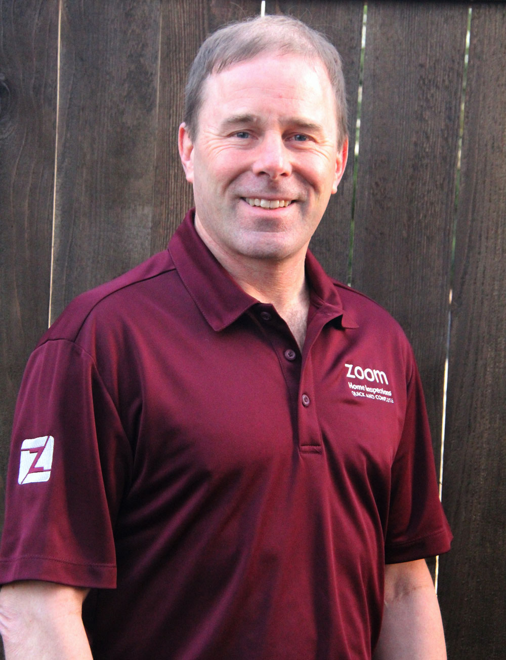 A picture of Brian wearing a shirt that says Zoom Home Inspections. Brian is the owner of Zoom Home Inspections.